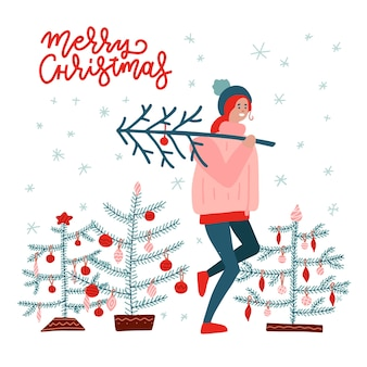 Girl carrying a christmas tree. merry christmas and happy new year.