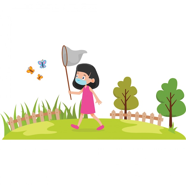 A girl catching a butterfly on the field while using medical mask