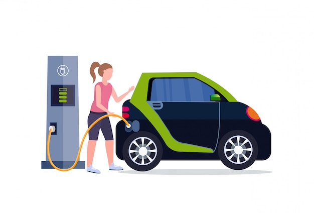 Girl charging electric car at electrical charge station renewable eco technologies clean transport environment care concept  full length