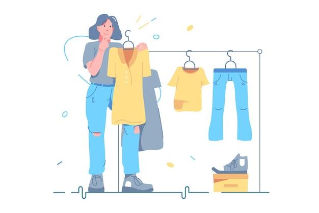 상점 벡터 일러스트 레이 션에 옷을 선택 하는 소녀. 옷걸이 걸이 앞에 서서 복장 플랫 스타일을 선택하는 여자. 패션, 옷가게, 쇼핑 컨셉입니다. 흰색 배경에 고립