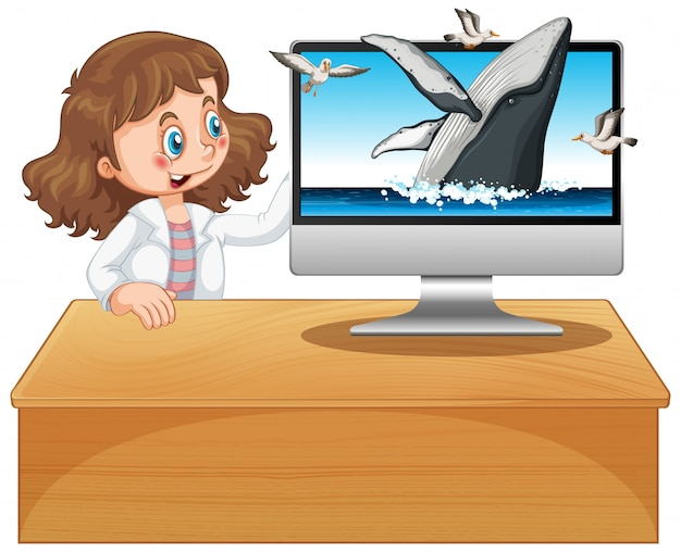 Girl next to computer with humpback whale background