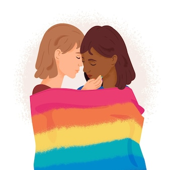 Girl couple covering themselves with a pride flag
