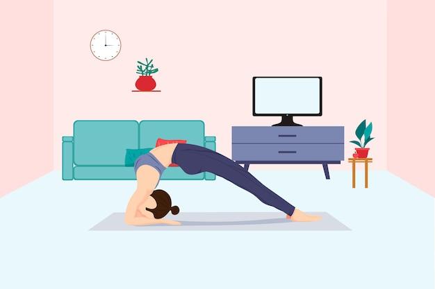 女の子は体と精神のお気に入りの趣味を強化するためにテレビのヨガのポーズで自宅でオンラインでヨガをします