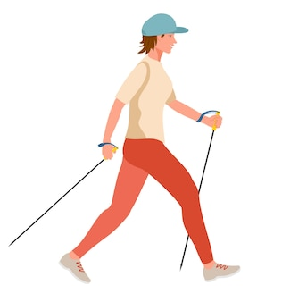 屋外でノルディックウォークをしている女の子ノルディックウォーキングをしているウォーキングポールでハイキングしている若い女性