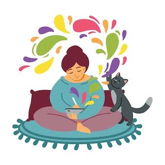 Девушка рисует на планшете. кошка играет на ковре. женщина уютно проводит время на любимой работе. фрилансер-дизайнер, работа на дому. компьютерное или цифровое искусство. будьте креативны. иллюстрации.