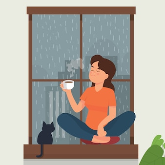Girl drink tea/coffee near window while rain outside