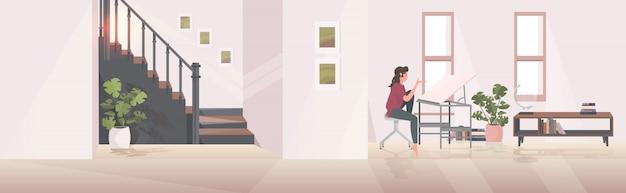 노트북 조정 가능한 그리기 책상 현대 거실 인테리어를 사용하여 직장에 앉아 소녀 엔지니어