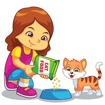 Girl feeding her pet cat.