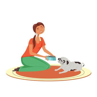 Девушка кормит мопса миску сухим кормом