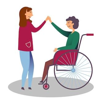 ガールフレンドは男の子の車椅子を無効にしました優しさの子供たちの障害を示しています
