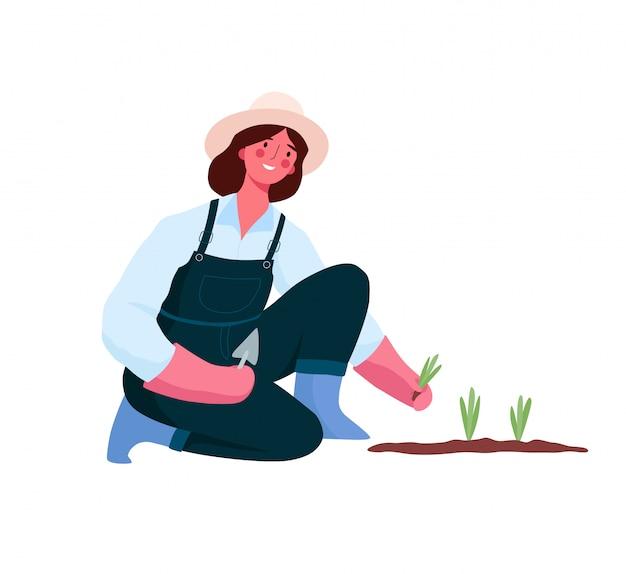 Девочка садится, ухаживает за своими растениями. молодая женщина работает в саду или на ферме