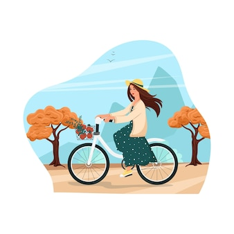 Girl in a hat and dress rides a bicycle autumn landscape vector illustration