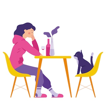 A girl have a dinner with her cat in a dining room