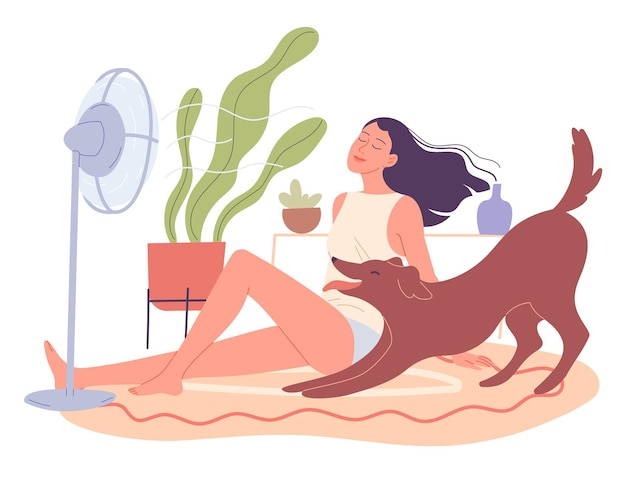 Girl and her dog are chilling at home by the fan.