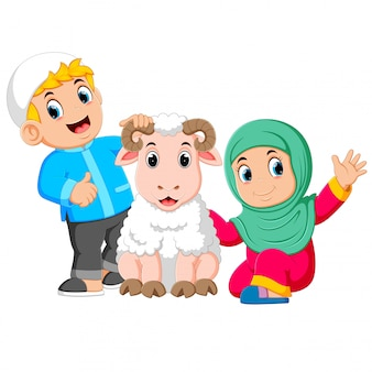 The girl and her father are holding the big white sheep