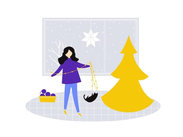 크리스마스 트리를 장식하는 화환을 들고 있는 소녀 고양이는 조명을 가지고 노는 아늑한 겨울 장면