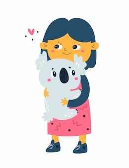 Девушка держит коалу