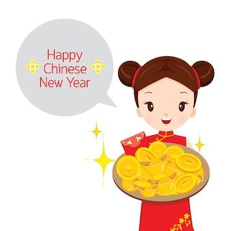 金の皿を持っている女の子、伝統的なお祝い、中国、幸せな中国の旧正月