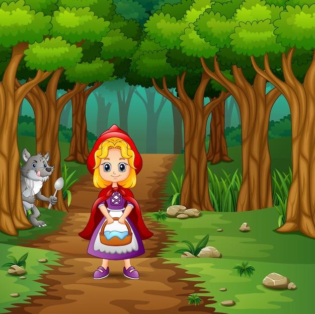 女の子は森で赤とオオカミをフードした
