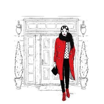 クリスマスの帽子とコートを着た女の子。ドア。