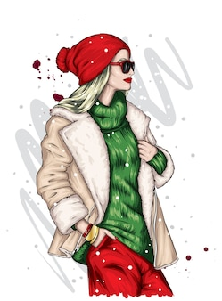 クリスマスの帽子とコートを着た女の子。