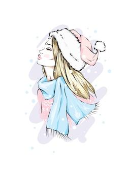 크리스마스 모자와 스카프에 소녀입니다.