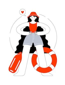 파나마 모자와 수영복을 입은 소녀가 바다에서 인명 구조 원으로 일합니다.
