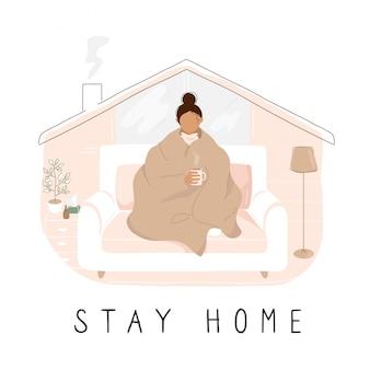 Девушка в одеяле на карете и надпись «стой домой»