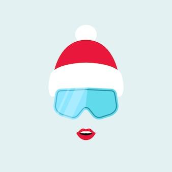 スキーゴーグルと冬の赤い帽子の女の子