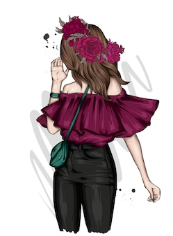 スタイリッシュな服と花の花輪の女の子