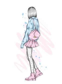세련된 옷을 입은 소녀와 배낭