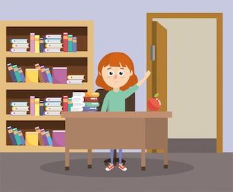 机と教育書の教室の中の少女