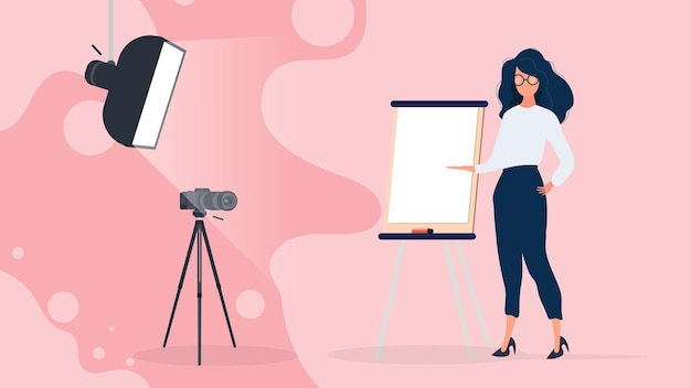 The girl is giving a presentation in front of the camera.