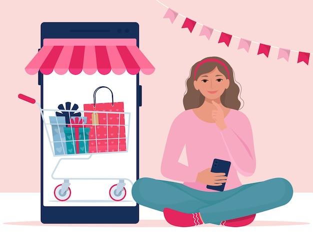소녀는 스마트 폰을 통해 구매하고 있습니다. 발렌타인 판매, 온라인 쇼핑 개념입니다. 플랫 스타일의 일러스트레이션
