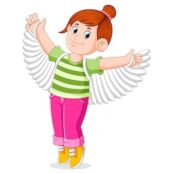The girl is trying the fake wings for prepare the dance