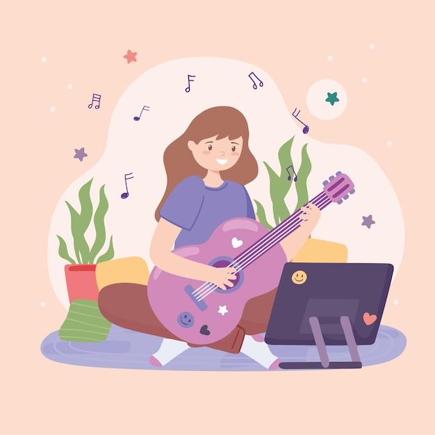 Девушка учится на гитаре онлайн