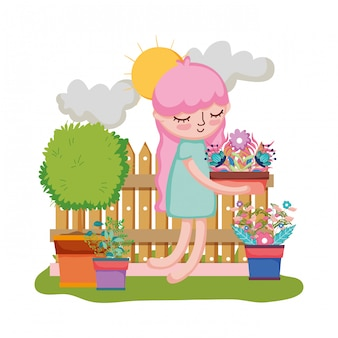 Girl lifting houseplant with fence in the garden