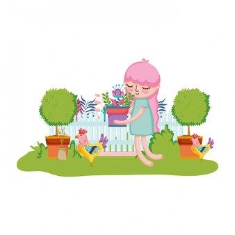庭でオンドリと観葉植物を持ち上げる女の子
