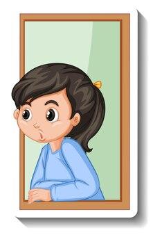 窓の漫画のステッカーを探している女の子