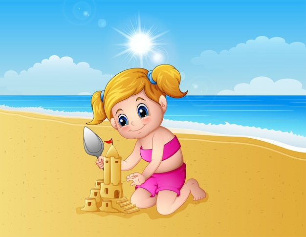 Girl making sand castle at the beach