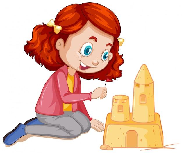 Девушка делает замок из песка на белом фоне