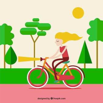 公園の背景で彼女の自転車にガールズ
