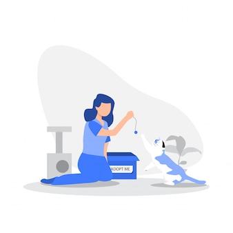 여자는 바닥에 그녀의 고양이와 놀고입니다. 프리미엄 벡터