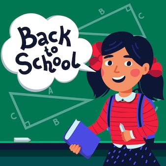 Girl pupil in front of blackboard with back to school text