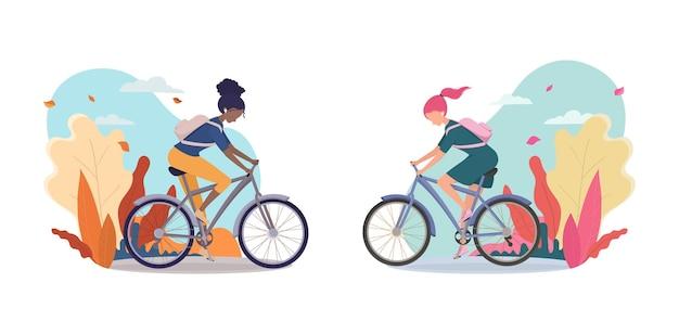 女の子は自転車に乗り、アフリカ系アメリカ人の女性は秋の風景の中で自転車に乗ります。自転車店、スポーツウェア、はがきのポスターまたはバナー