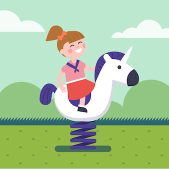 Girl riding a spring horse ride at park playground