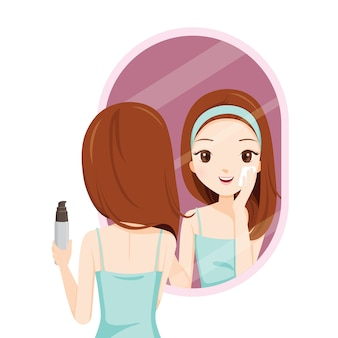 Girl scrubbing her face and see herself in mirror