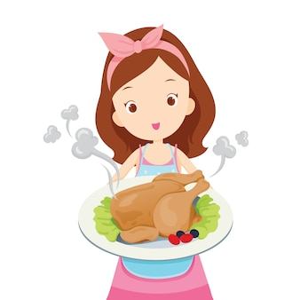 Девушка показывает жареную курицу на блюде, она готовит сама