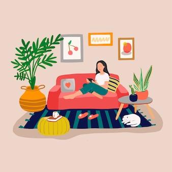 座っているとタブレットコンピューターが付いているソファーで休んでいる女の子。オンラインで時間を過ごす若い女性。観葉植物と猫がいるスカンジナビアスタイルの居心地の良いインテリア。フラットな漫画のスタイルのカラフルなイラスト
