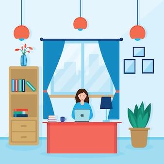 机に座ってコンピューターで作業している女の子